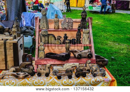 VELIKY NOVGOROD RUSSIA - JUNE 11 2016. Souvenirs at the Russian fair - wooden handmade little sculptures and toys made in traditional Russian style