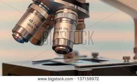Microscope and test tubes in laboratory, Blue toned image