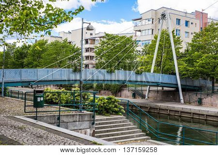 Helsinki, Finland - June 12, 2016: Pedestrian Cable-stayed Bridge Across The River Channel In Reside