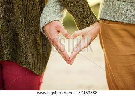 A couple giving hands in the street