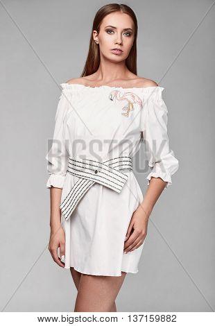 Portrait Of Fashion Glamor Stylish Woman In White Skirt