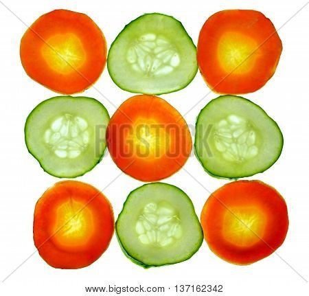Round slices of carrot and cucumber / isolation on a white background without shadows /. Salad. Diet. Vegetarianism. Summer season. Healthy eating. /top view/
