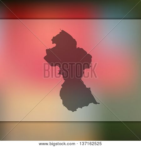 Guyana map on blurred background. Blurred background with silhouette of Guyana. Guyana.