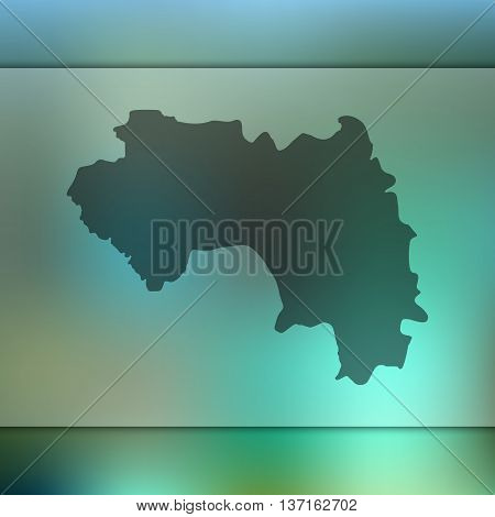 Guinea map on blurred background. Blurred background with silhouette of Guinea. Guinea.