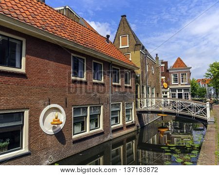 Canal and houses in Gouda by day, Netherlands