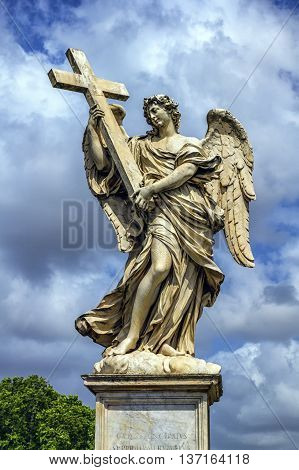 Angel with the Cross statue on the Ponte Sant' Angelo bridge by day, Rome, Italy