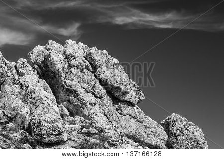 Large outcropping of rocks and boulders in b/w