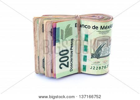 A Stack of Mexican Currency bills on white background