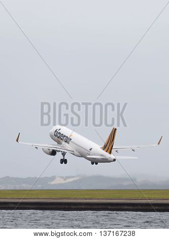 Sydney - February 26 2016: Big passenger Airbus A320-232 Tiger Airways Australia takes off on the runway at the international airport in Sydney February 26 2016 Sydney Australia