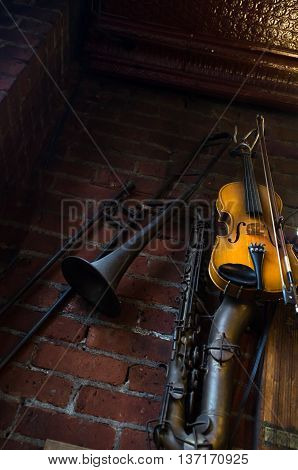 Jazz club instruments hang on brick wall at night