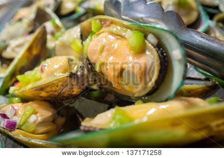 Pile of fresh seasoned mussel shellfish served cold on ice