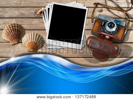 Vintage camera with leather case a group of empty instant photos seashells and blue sea waves on a wooden boardwalk with sand
