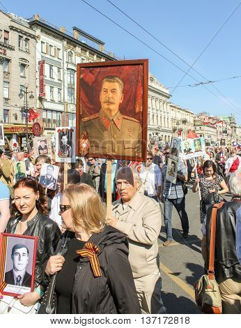 St. Petersburg, Russia - 9 May, A man carrying a portrait of Stalin, 9 May, 2016. Memory Action