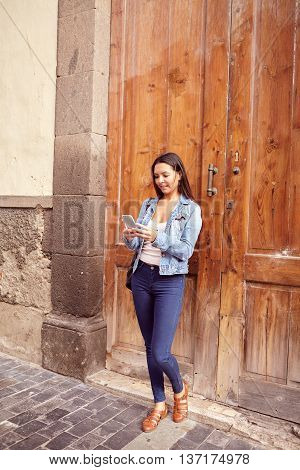 Pretty Young Girl Leaning Against Wooden Doors