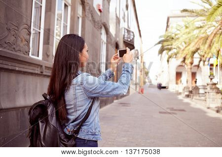 Pretty Young Girl Taking Pictures With Cell Phone
