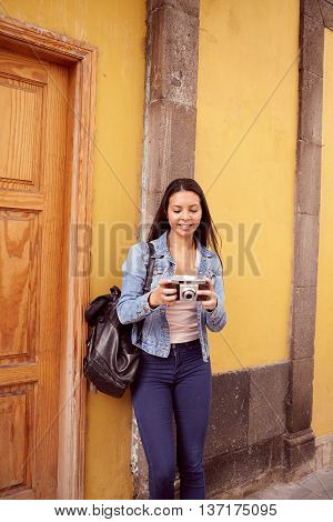 Pretty Young Girl Leaning Against A Grey Pillar