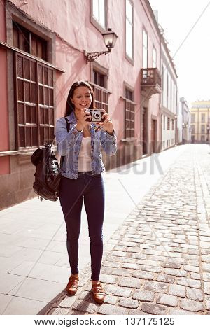 Pretty Young Girl Focusing To Taking A Picture