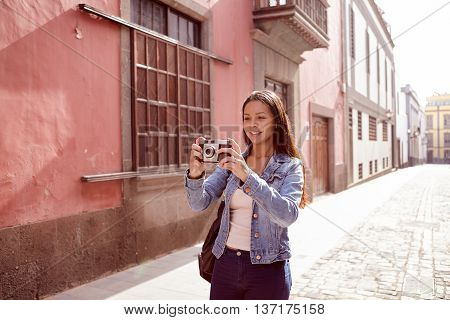 Pretty Young Girl Taking A Picture With Her Camera