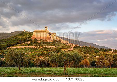 Assisi (Umbria) at sunset with basilica di san francesco