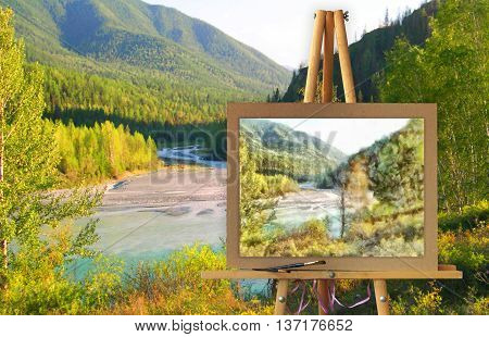 Easel with a painting watercolor illustration of Altai Mountains on a canvas on a landscape. Distant horizon attracts attention and the river road calls for adventure. Photo manipulation concept.