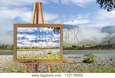 Easel with a painting watercolor illustration of Altai Mountains on a canvas on a landscape. Lost settlement river road misty high peaks of Altai Mountains fresh air undisturbed pristine nature. Photo manipulation concept.