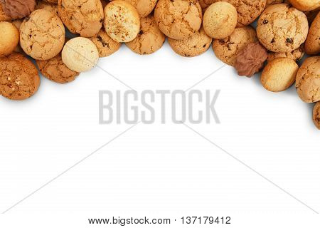 Cookies background. Sweet chocolate chips biscuits heap isolated at white background with copy space. Oatmeal, chocolated drops and other sweets. Fattening dessert for tea.