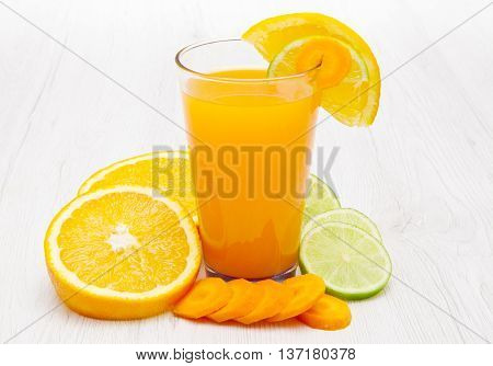 Glasses of ace juice with carrot , orange and lemon