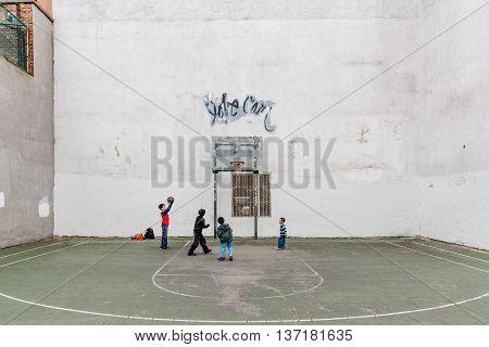 Group Of Kids Playing Basketball