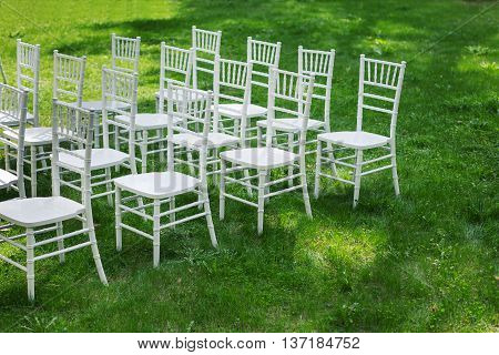 Chiavari chairs on grass. Beautifully arranged, prepared for the ceremony
