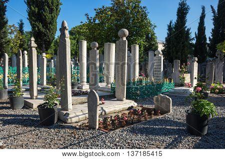 ISTANBUL TURKEY - JUNE 20 2015: Old tombstones beside The Suleymaniye Mosque in Istanbul Turkey