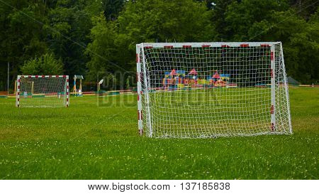 A view of a net on a vacant soccer pitch.