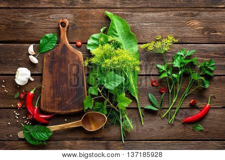 dark culinary background with various herbs and spices, top view, rustic style