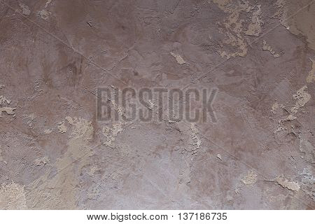 Texturized dark brown and beige putty. Vintage or grungy background of venetian stucco texture as pattern wall.