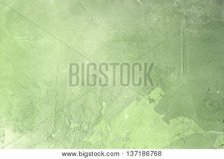 Texturized green putty. Vintage or grungy background of venetian stucco texture as pattern wall.