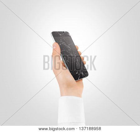 Hand holding broken phone with smashed touch screen, cipping path. Arm hold cracked smartphone, isolated. Smart mobile cellphone display scratch. Telephone monitor problems, need repair.