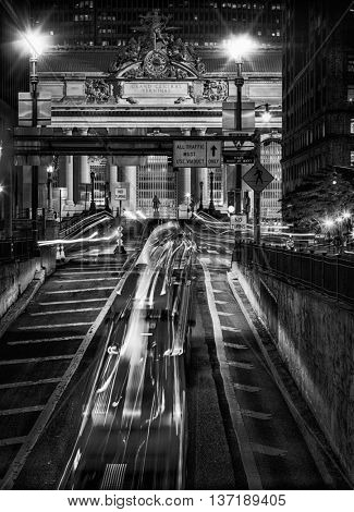 Yellow cabs speeding towards Grand Central Station in New York City in black and white