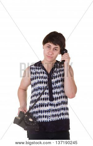A young woman using a rotary phone isolated on white