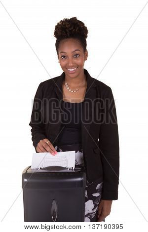 A young business woman shredding a document