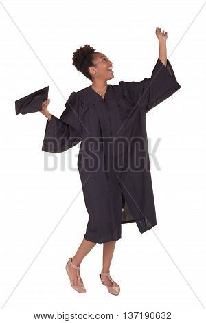 A young college graduate in a cap and gown isolated on white