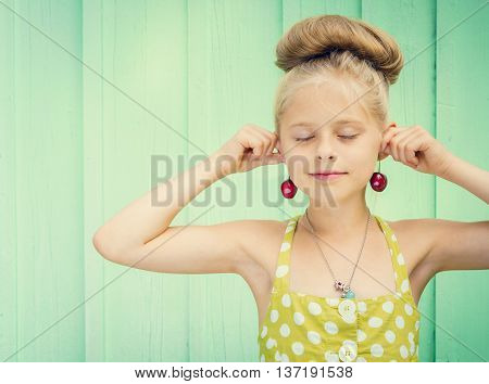 Beautiful girl holding cherries as earrings -style Rockabilly. Space for text