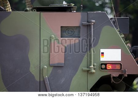 door with a smiley on military armoured vehicle door