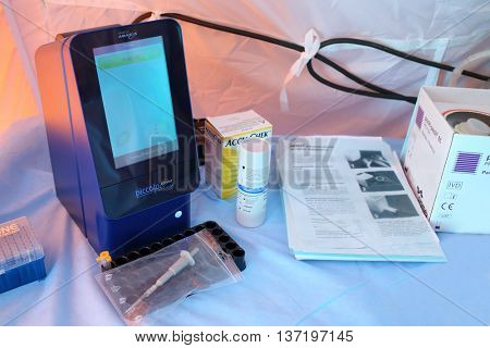 MOSCOW - APR 28, 2015: Portable diagnostic device Piccolo Xpress chemistry analyzer on a table in a modular tent of the field hospital
