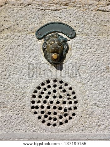 Characteristic old door bell in Venice with intercom