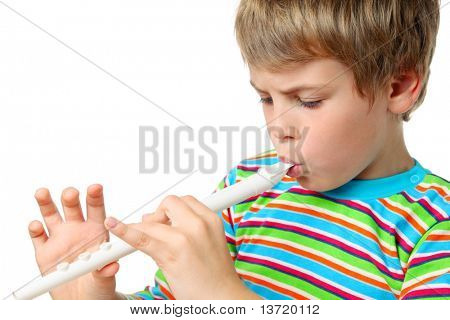 Small blonde boy in striped shirt with zeal blows white horn