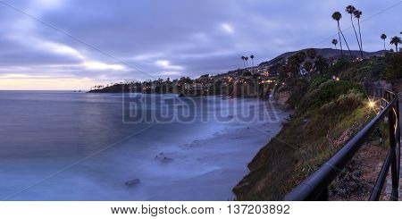 Dark clouds over Diver's Cove in Laguna Beach at sunset in the summer.
