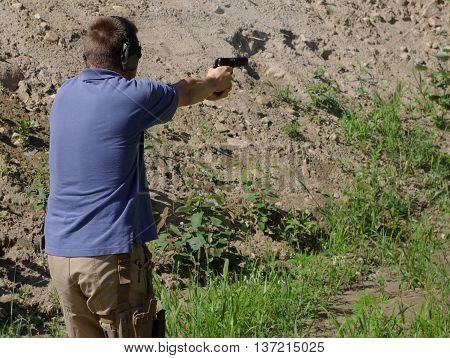 Firing the M1911 on the range walking down