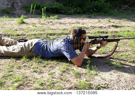 Firing a 30-06 on a rifle range in the prone poastion