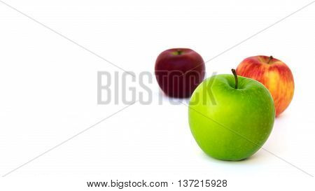 Three Different Color Apples (New Zealand Eve Granny Smith Ambrosia) Isolate on White Background with Copy Space Selective Focus
