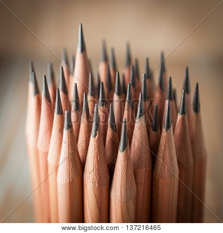 Sharp pencils with wooden background. close-up pencils