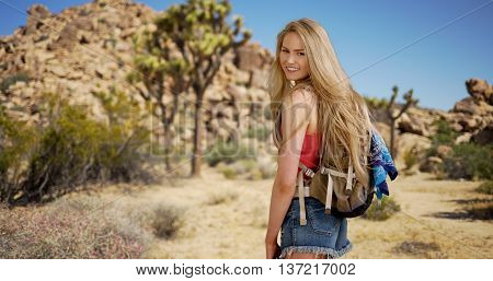 Lovely Young Adult Female Hiking Joshua Tree Park In Spring